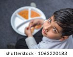 indian school children eat... | Shutterstock . vector #1063220183