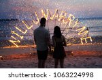 Small photo of surprise propose merry me to wedding fire sunset