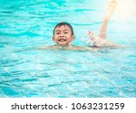 blurred boy swimming in... | Shutterstock . vector #1063231259