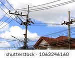 electric pole with blue sky... | Shutterstock . vector #1063246160