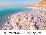 salt on the shore of the dead... | Shutterstock . vector #1063259060