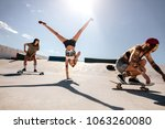 woman doing flip with female...   Shutterstock . vector #1063260080