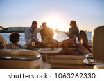 young rich friends drinking... | Shutterstock . vector #1063262330