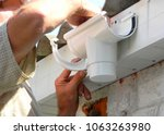 contractor installing plastic... | Shutterstock . vector #1063263980