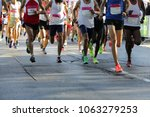 marathon running race. legs and ... | Shutterstock . vector #1063279253