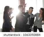 Small photo of Portrait of a professional business team celebrate their victory