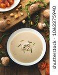 creamy mushroom soup on wood... | Shutterstock . vector #1063375940