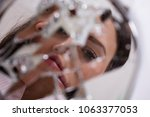 reflection of a woman's face in ... | Shutterstock . vector #1063377053