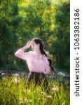 dreamy girl on a summer sunny... | Shutterstock . vector #1063382186
