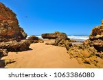 torquay is promoted as the... | Shutterstock . vector #1063386080