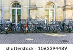 a row of bicycles at maastricht ... | Shutterstock . vector #1063394489