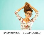 funny pretty young woman in... | Shutterstock . vector #1063400060