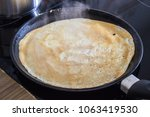 french crepe  thin pancake on a ... | Shutterstock . vector #1063419530