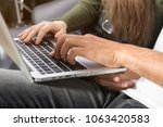 young couple using laptop | Shutterstock . vector #1063420583