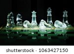 glass chess pieces on board... | Shutterstock . vector #1063427150