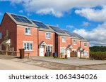 row of red brick english houses ... | Shutterstock . vector #1063434026