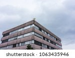 office building with grey sky... | Shutterstock . vector #1063435946