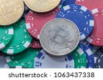 bitcoin on pile of casino chips ... | Shutterstock . vector #1063437338