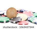 bitcoin on pile of casino chips ... | Shutterstock . vector #1063437344