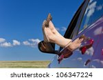Woman Legs In Car Window On...