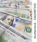 stack of 100 dollar bills | Shutterstock . vector #1063487243