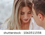 guy with a girl looking at each ... | Shutterstock . vector #1063511558