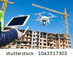 drone operated by construction... | Shutterstock . vector #1063517303