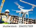 drone operated by construction... | Shutterstock . vector #1063517309