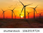 silhouette of wind turbines at...