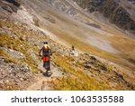 mountain bikers are travelling... | Shutterstock . vector #1063535588