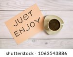 cup of coffee with text  just... | Shutterstock . vector #1063543886
