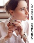 cute girl sitting in a cafe ... | Shutterstock . vector #1063581464