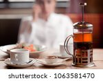 on the table in the cafe there... | Shutterstock . vector #1063581470