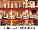 on the shelf are banks with... | Shutterstock . vector #1063581488