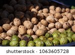 walnuts on the counter at the...   Shutterstock . vector #1063605728