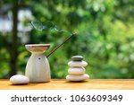 aroma lamp with incense stick... | Shutterstock . vector #1063609349