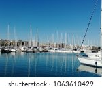 yachts in a tourist port | Shutterstock . vector #1063610429