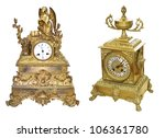 Antique gold colored table clocks - stock photo