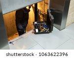 specialist fixing or adjusting... | Shutterstock . vector #1063622396