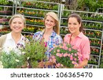 Three Women Holding Potted...