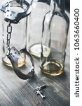 Small photo of Alcohol addiction objects isolated on wooden key for help