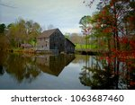 the old gristmill or watermill... | Shutterstock . vector #1063687460