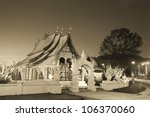 Laos wooden temple in sunset - stock photo