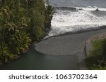 Small photo of Stream flowing into the ocean near the Ke'anae Peninsula in Maui, Hawaii