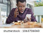 frustrated dark skinned male... | Shutterstock . vector #1063706060