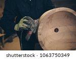 master carpenter working in his ...   Shutterstock . vector #1063750349