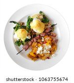 poached eggs in hollandaise... | Shutterstock . vector #1063755674