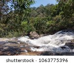 the stream in forest. royalty... | Shutterstock . vector #1063775396