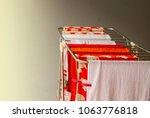dry red orange white towel... | Shutterstock . vector #1063776818