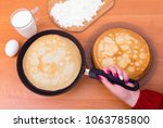 wonam holding a frying pan with ... | Shutterstock . vector #1063785800